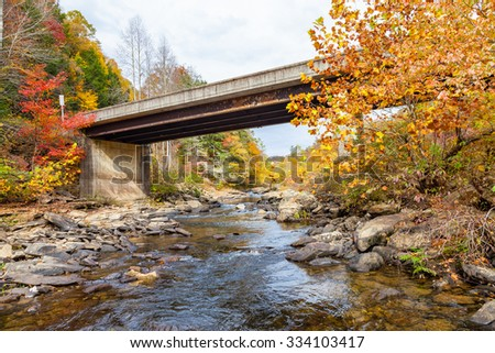 Fall color at Lilly Bridge, Obed Wild and Scenic River - stock photo