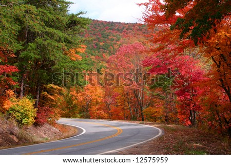 Fall color on curve in rural Northwest Georgia Mountains - stock photo