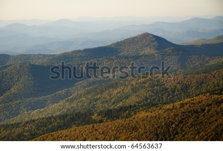 fall colors at sunrise from the summit of Mount Mitchell - stock photo