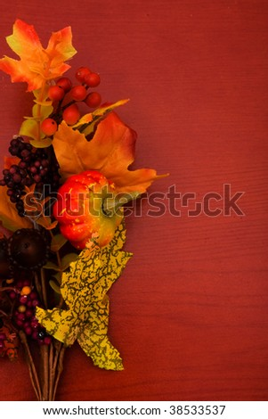 Fall coloured leaves making a border on a wooden background, Fall Leaves - stock photo