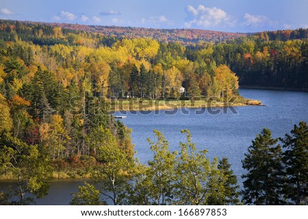 Fall foliage of the deciduous forests along the Trout River in rural Prince Edward Island, Canada. - stock photo