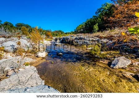 Fall Foliage on a Crystal Clear Creek in the Hill Country of Texas. - stock photo