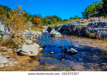 Fall Foliage on a Rural Crystal Clear Creek in the Hill Country of Texas - stock photo