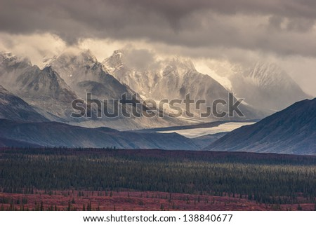 Fall photograph of mountains and receding glaciers - stock photo