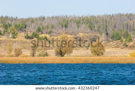 fall river. Autumn colorful foliage over lake with beautiful woods in red and yellow color. Autumn landscape with a river. Beautiful autumnal scene, fall - stock photo