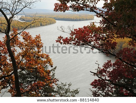 Fall scene: oak trees frame Mississippi River on a hazy day, viewed from Effigy Mounds National Monument, Iowa - stock photo