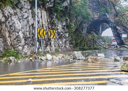 Fallen rocks and debri caused by typhoon - stock photo