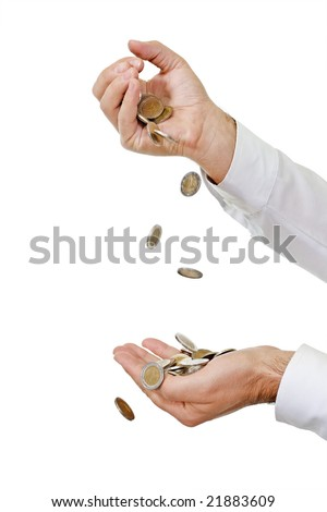 Falling coins into hand - stock photo