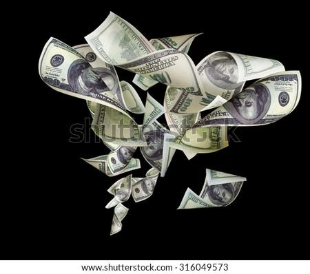 Falling dollars isolated on black background - stock photo