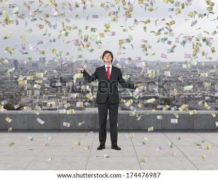 Falling down euros and businessman 4 - stock photo