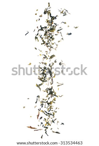 Falling dried green tea leaves isolated on white background. - stock photo
