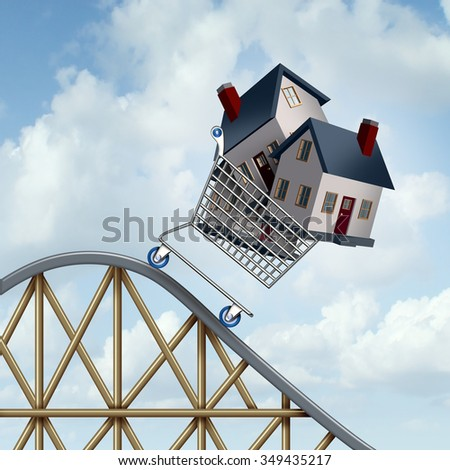 Falling home prices and declining real estate value financial concept as sold houses in a shopping cart going down a roller coaster as a business financial concept. - stock photo