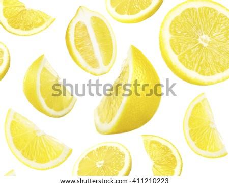 Falling ripe lemons isolated on white - stock photo