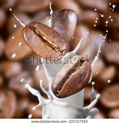 Falling roasted coffee beans with steam and milk splash - stock photo