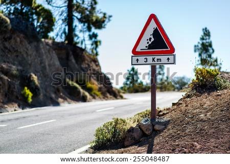 Falling rocks sign. Road to Teide volcano. Tenerife, Canary Islands. Spain - stock photo