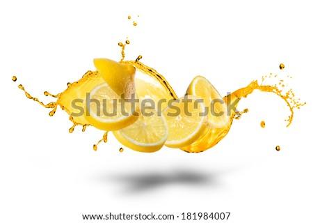 Falling slices of lemon with juice splash isolated on white - stock photo