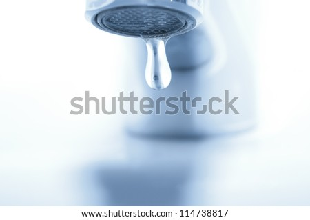Falling water droplet closeup - stock photo