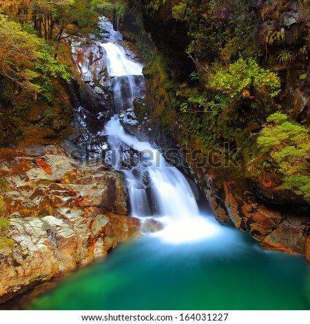 Falls Creek Waterfall on Autumn, South Island, New Zealand - stock photo