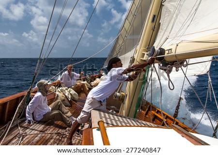 Falmouth, Antigua. 19th May 2015: Crew on Sincerity, racing in the Antigua Classic Yacht Regatta 2015 - stock photo