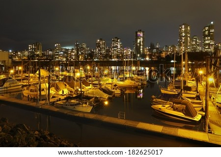 False Creek Marina Night, Vancouver. Looking across a False Creek marina at night towards the apartments and condominiums of Vancouver's West End. British Columbia, Canada.  - stock photo