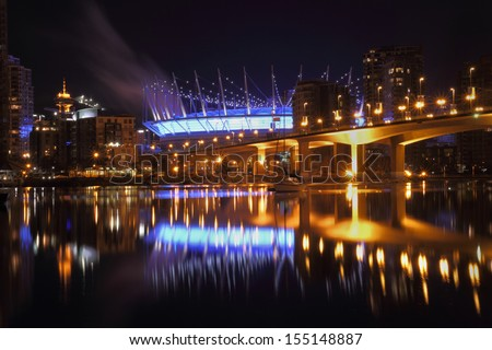 False Creek Vancouver Night Reflections. False Creek and the Cambie Street bridge at twilight in downtown Vancouver. British Columbia, Canada.  - stock photo