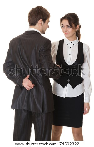 false deal, man and woman doing the handshake, the man crossed his fingers behind his back, isolated on white - stock photo