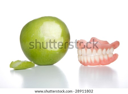 False teeth just took a bit out of an apple - stock photo