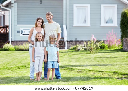 Families against the house - stock photo