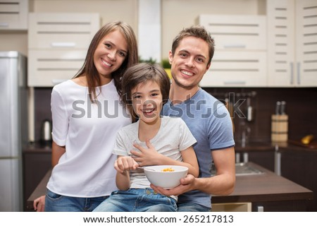 Families with a son in the kitchen - stock photo