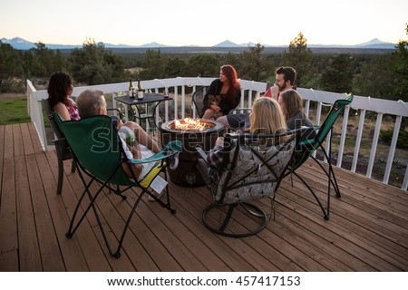 family and friends in conversation - stock photo