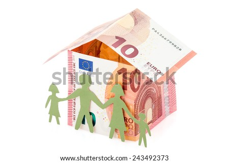Family and their Euro house made from banknotes  - stock photo