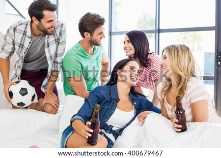 Family are enjoying their day with balloon and beer at home - stock photo