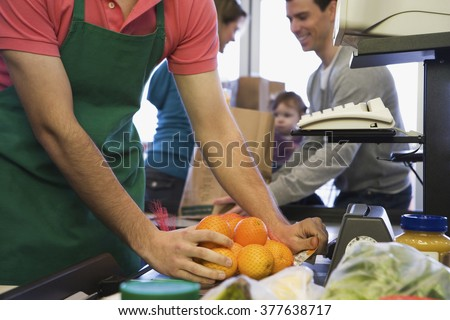 family at a supermarket checkout - stock photo