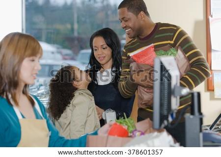 family at a till - stock photo