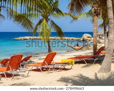 Family at Blue Bay beach Curacao ( Dutch Antilles)  an island in the Caribbean Ocean  - stock photo
