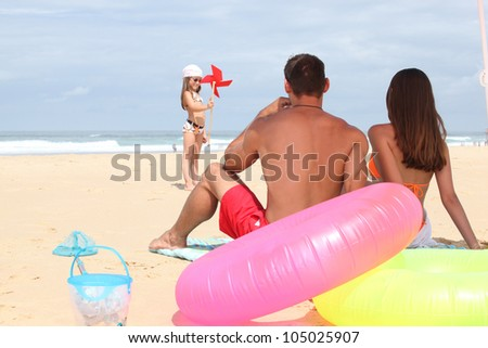 Family at the beach together - stock photo