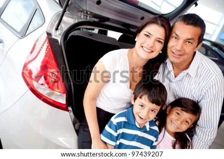 Family at the dealer buying a new car - stock photo