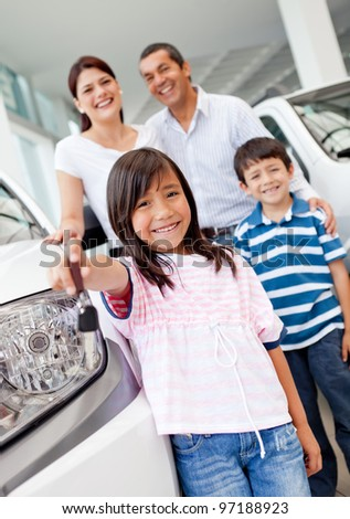 Family at the dealership buying a new car - stock photo
