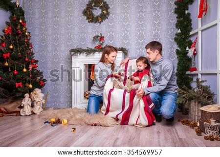 family atmosphere. parents play with the child. Christmas and new year - stock photo