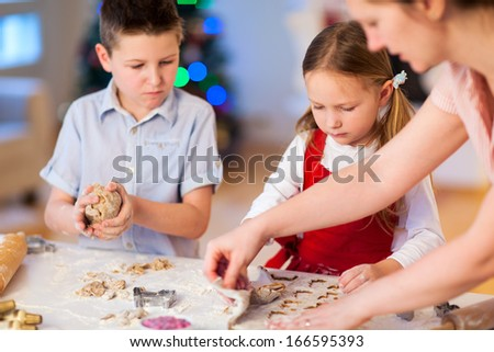 Family baking Christmas cookies at home - stock photo
