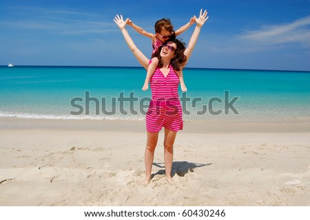 Family beach vacation, mother and her daughter - stock photo