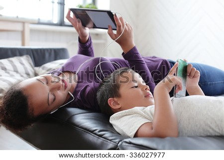 Family. Beautiful mother and her cute son - stock photo