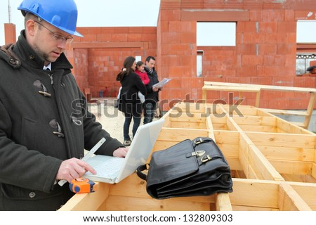 Family being shown around site - stock photo