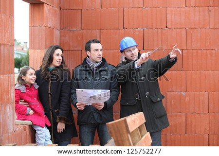 Family being shown around their new home - stock photo