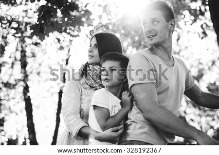 family bike tours Double.Visible noise at 100%. - stock photo
