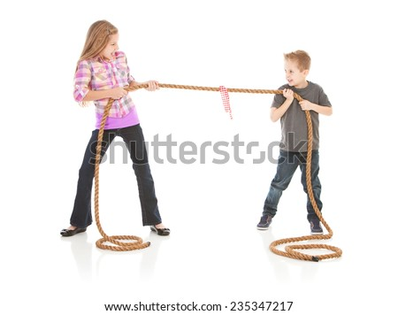 Family: Brother And Sister In Tug Of War Argument - stock photo