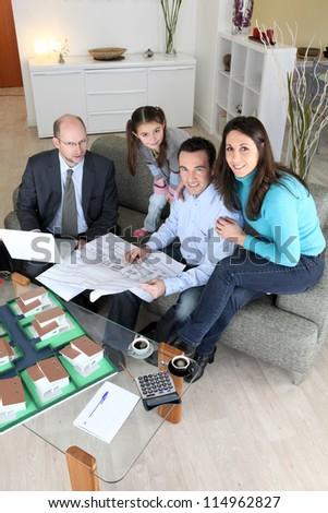 Family buying new house - stock photo