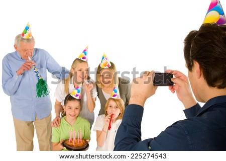 family celebrating birthday party with cake - stock photo