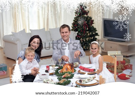 Family celebrating Christmas dinner with turkey against fir tree forest and snowflakes - stock photo