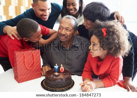 Family Celebrating 70th Birthday Together - stock photo